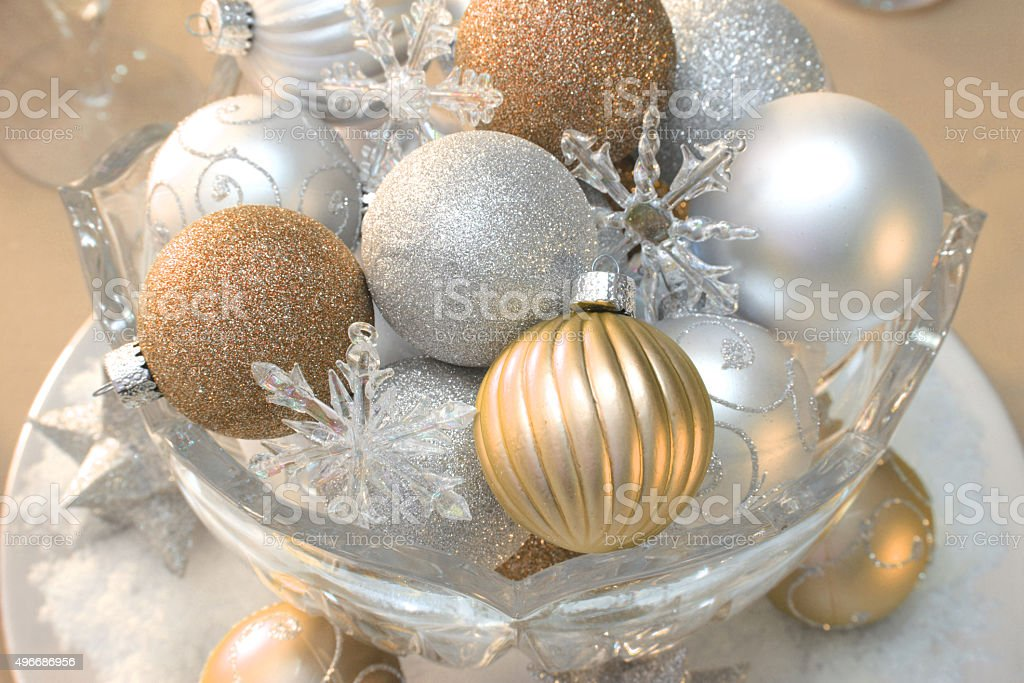 Holiday: gold silver and white Christmas ornaments in a bowl stock photo