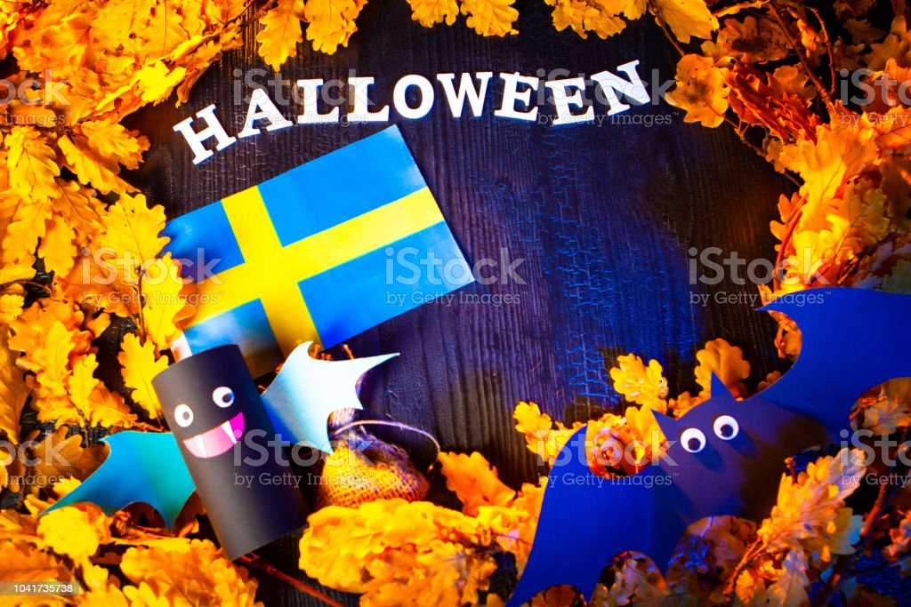 Holiday Halloween. Sweden. Autumn holiday. Vampires against the background of yellow leaves. Decoration for the holiday of Halloween in Sweden. the flag of Sweden. stock photo