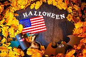 Holiday Halloween. USA Autumn holiday. Vampires against the background of yellow leaves. Decoration for the holiday of Halloween in the United States of America. American flag.