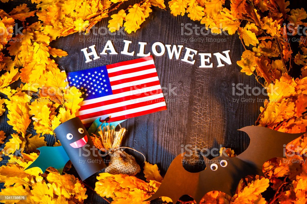 Holiday Halloween. USA Autumn holiday. Vampires against the background of yellow leaves. Decoration for the holiday of Halloween in the United States of America. American flag. stock photo