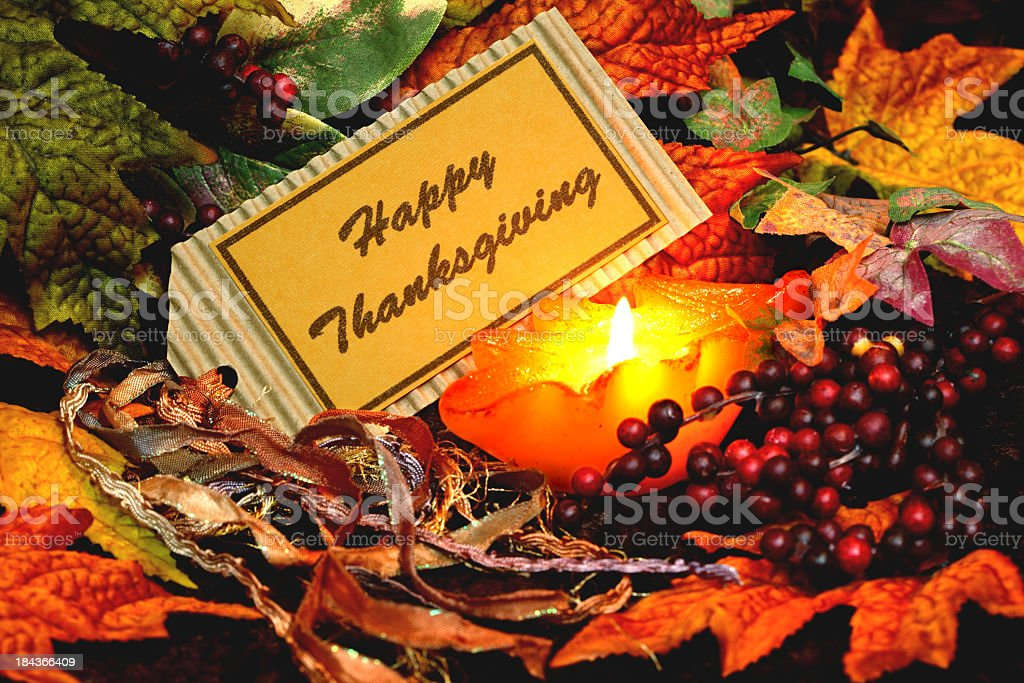 Holiday: Happy Thanksgiving Tag with Candle, berries and leaves royalty-free stock photo