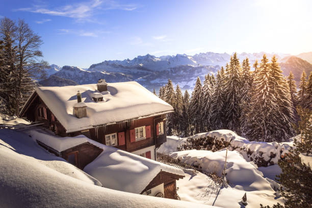 Holiday home in mountains in the winter with snow beautiful snowoy winter landscape in swiss mountains chalet stock pictures, royalty-free photos & images