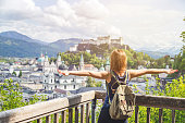 Female tourist is enjoying the view over the historic district of Salzburg