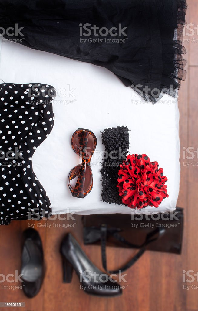 Holiday in spain flamenco like outfit on the hotel bed stock photo