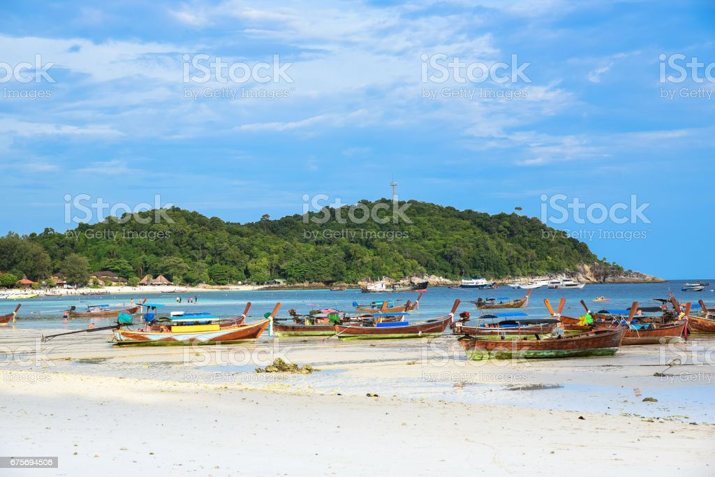 Holiday in Thailand - Beautiful Island of Koh Lipe with long tail boat by the beach at Satun, Thailand. stock photo