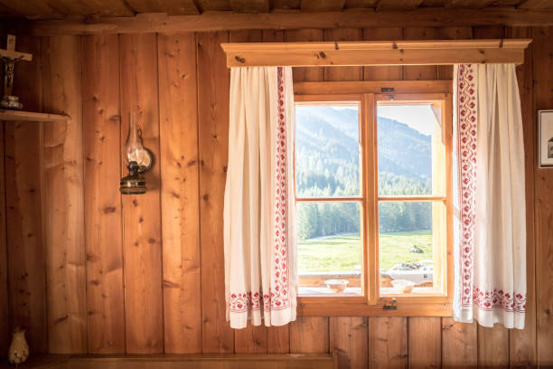 Holiday in the mountains: Rustic old wooden interior of a cabin or hut Inside of a rustic wooden hut or cabin, Austria chalet stock pictures, royalty-free photos & images