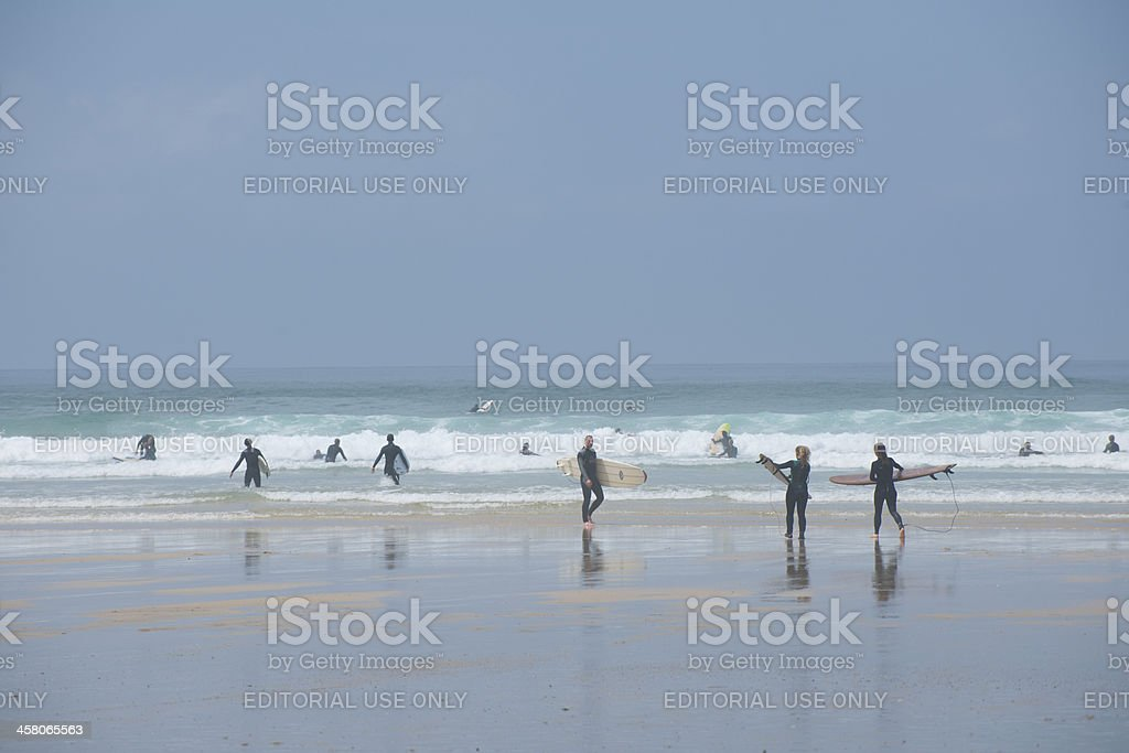 Holiday makers and surfers on Fistral Beach stock photo