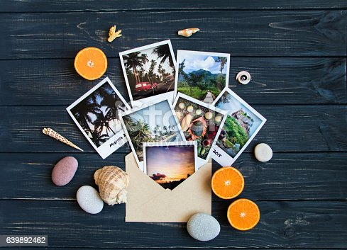 istock Holiday memories: photos, stones, seashells on travel photo. Flat lay 639892462