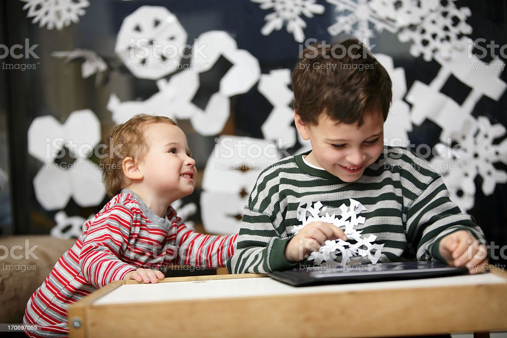 Holiday play time with brothers royalty-free stock photo