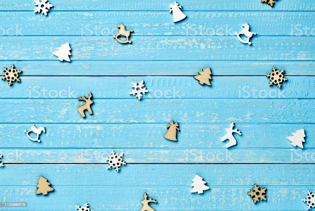 Holiday postcard. Christmas wooden decorations of fir, deer,...