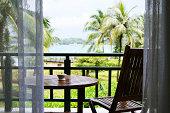 Lawn chair facing a great tropical sea view.