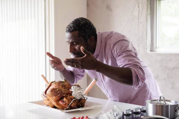 Holiday Season family and friends multi-ethnic during thanksgiving dinner stock photo