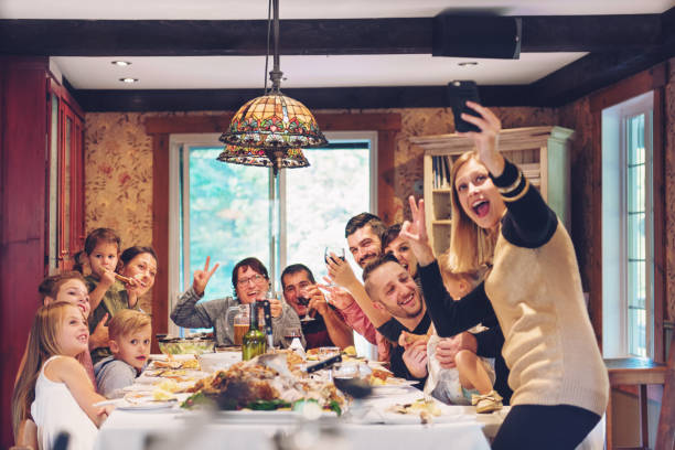 holiday season - family dinner stock photos and pictures