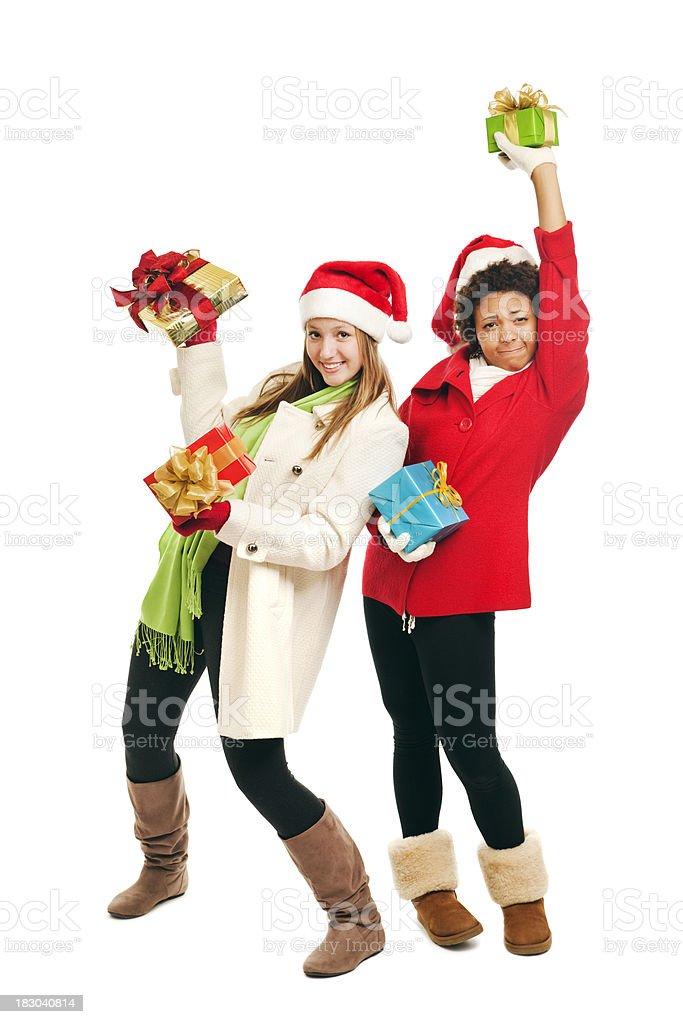 Holiday Season Teen Girls in Santa Hat with Christmas Gifts royalty-free stock photo