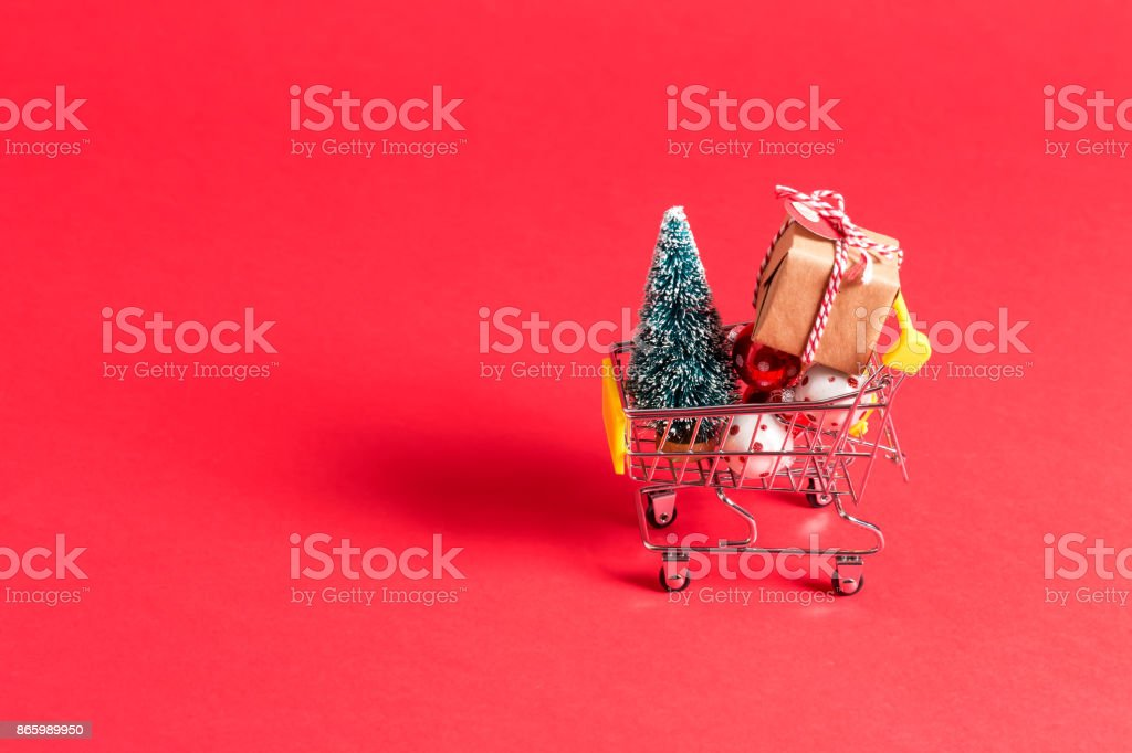 Holiday shopping theme with shopping cart stock photo