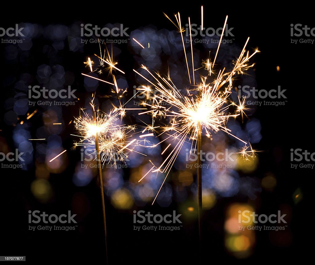 Holiday sparkler christmas sparkler on colorful lights background Abstract Stock Photo