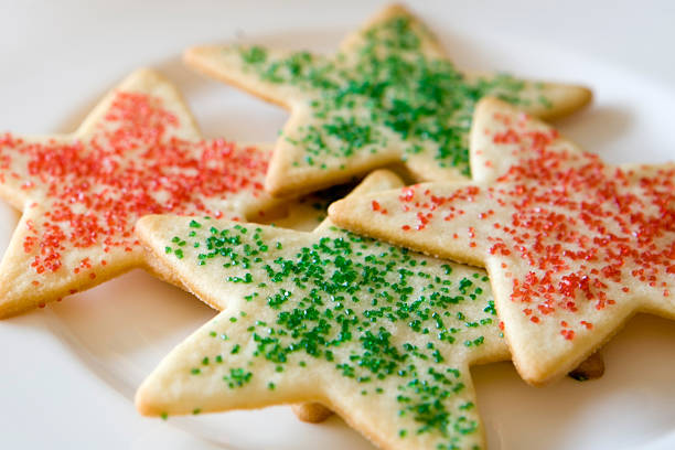 Holiday Sugar Cookies Star-shaped holiday sugar cookies sprinkled with red and green sugar.  Selective focus.For more Christmas imagery: sugar cookie stock pictures, royalty-free photos & images