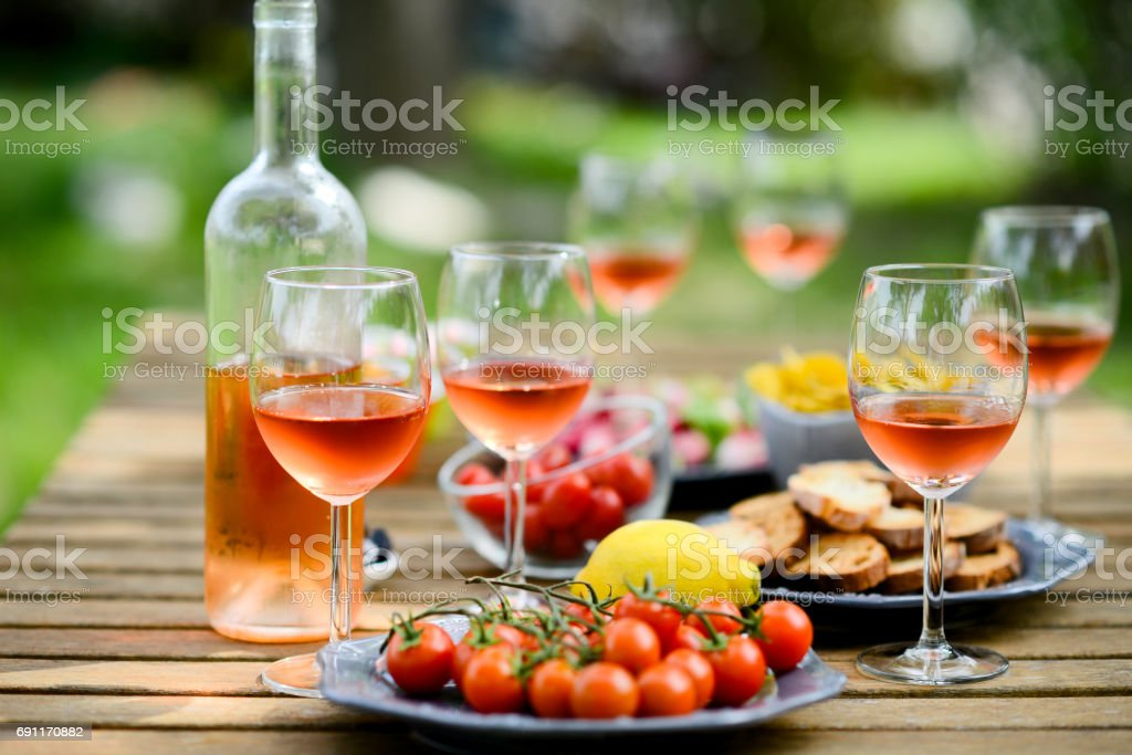holiday summer brunch party table outdoor in a house backyard with...