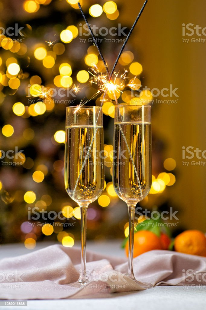 Holiday table, Christmas, new year. Champagne in wine glasses sparklers stock photo