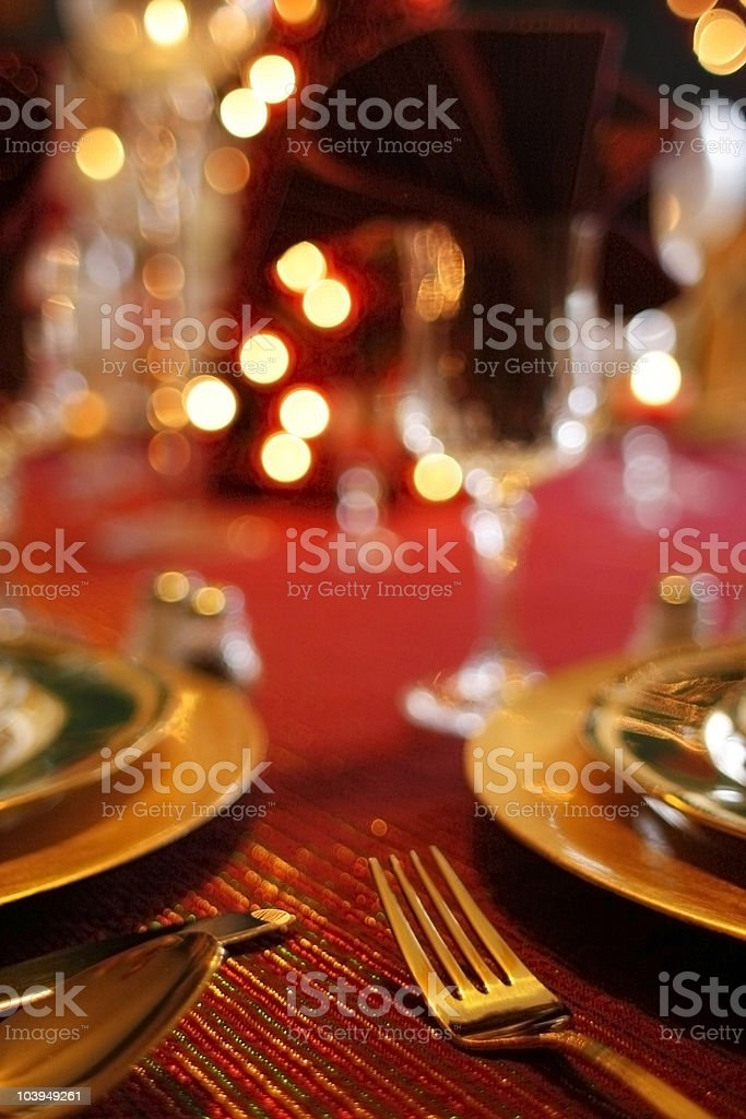 Holiday Table Setting: Gold and Red Color Scheme royalty-free stock photo