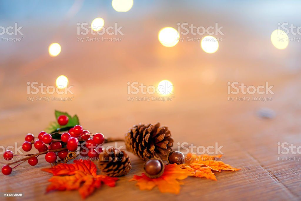 Holiday tabletop decorations of holly and pinecones for Thanksgiving...