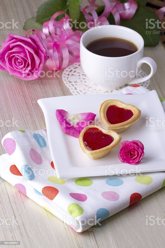 Holiday Tartlets with jam near the cup of tea royalty-free stock photo