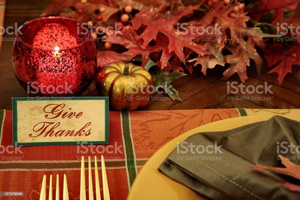 Thanksgiving Place setting with autumn colored plate, napkin, place...
