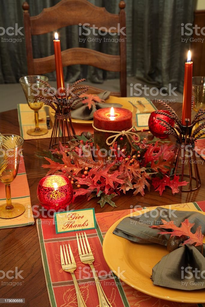 Thanksgiving table setting or Place setting with autumn colored...
