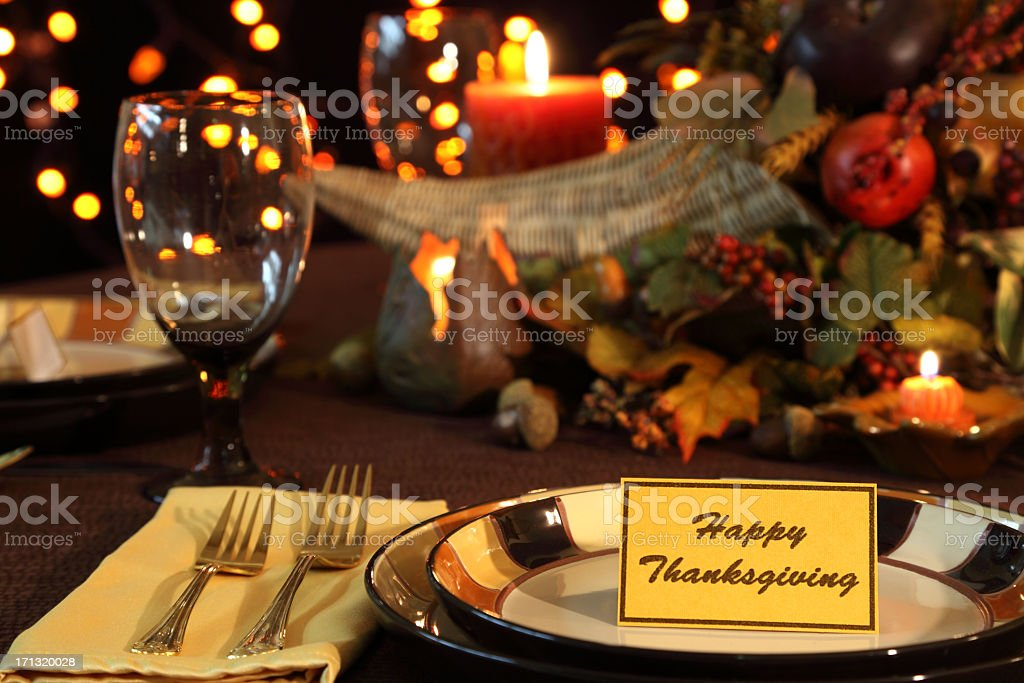 Thanksgiving Holiday table with cornucopia, candles, and lights....