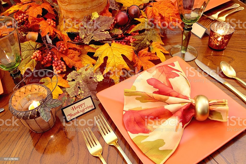 Thanksgiving Table setting with fall leaves and candles