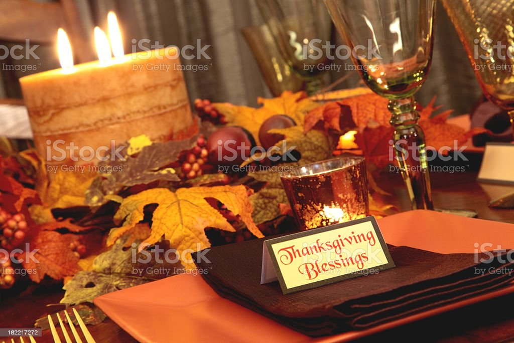 Holiday Thanksgiving table in autumn colored plates, leaves, candle,...