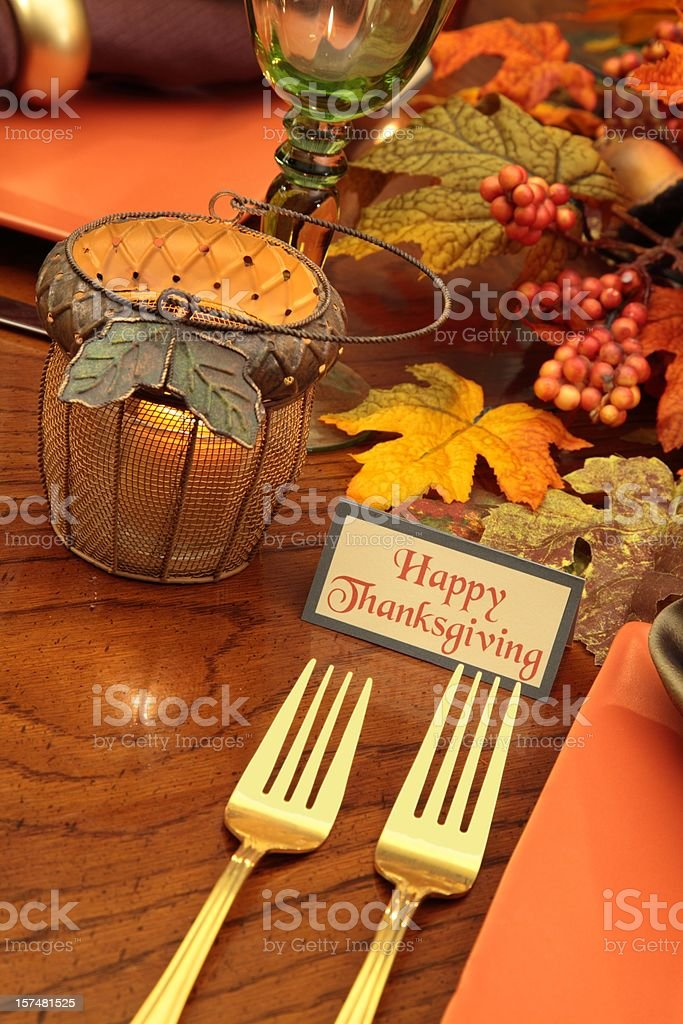 Thanksgiving Table with forks, fall leaves and candle