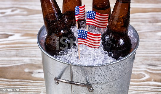 istock Holiday USA flags and bucket of ice cold beer 537882778