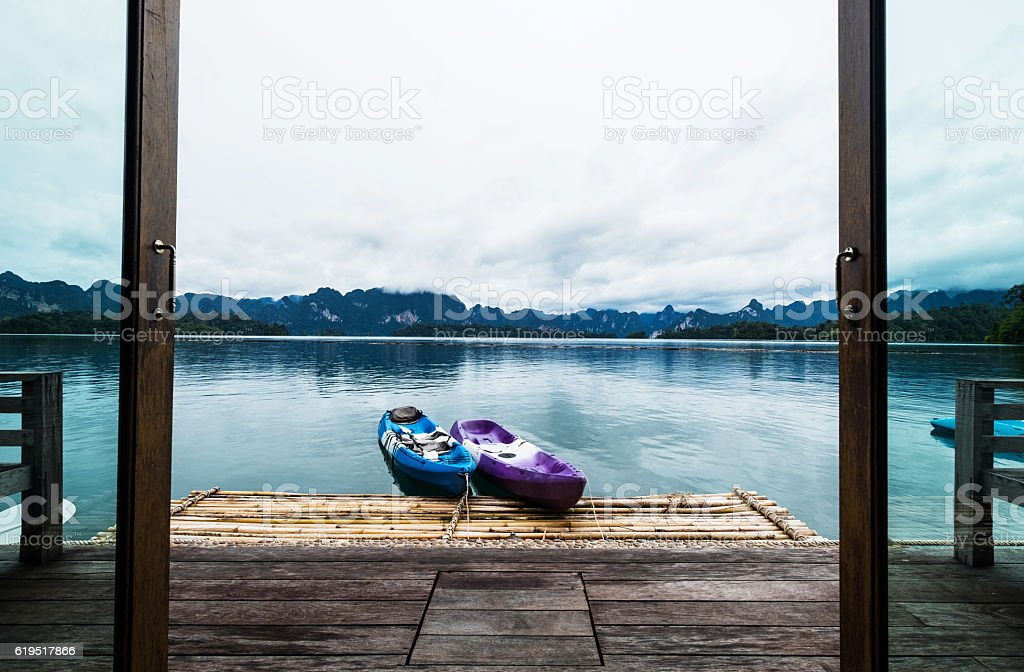 Holiday vacation, door opening to beautiful lake view on raft stock photo