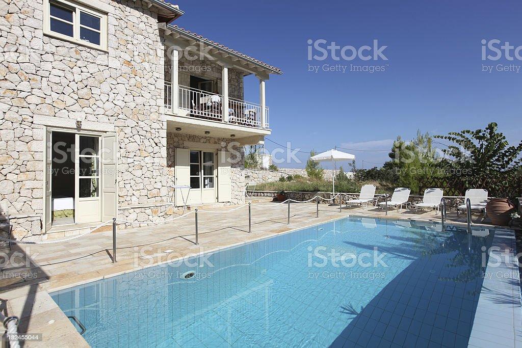 Holiday vacation villa exterior and swimming pool. royalty-free stock photo