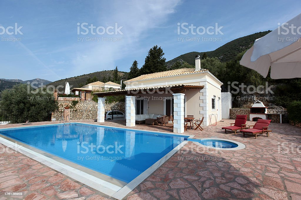Holiday vacation villa with a private swimming pool royalty-free stock photo