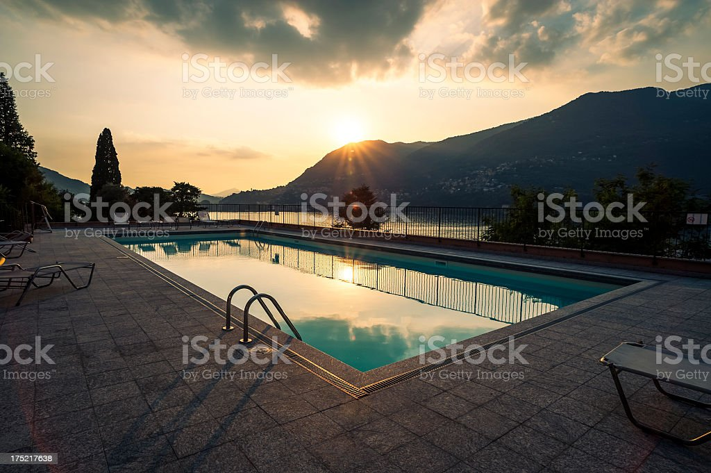 Holiday Villa With Swimming Pool At Sunset Stock Photo - Download