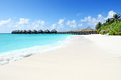 Holiday villas in lagoon,Tropical paradise beach resort of Maldives.