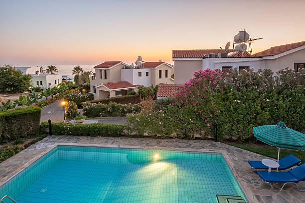 Holiday villas in sunset light stock photo