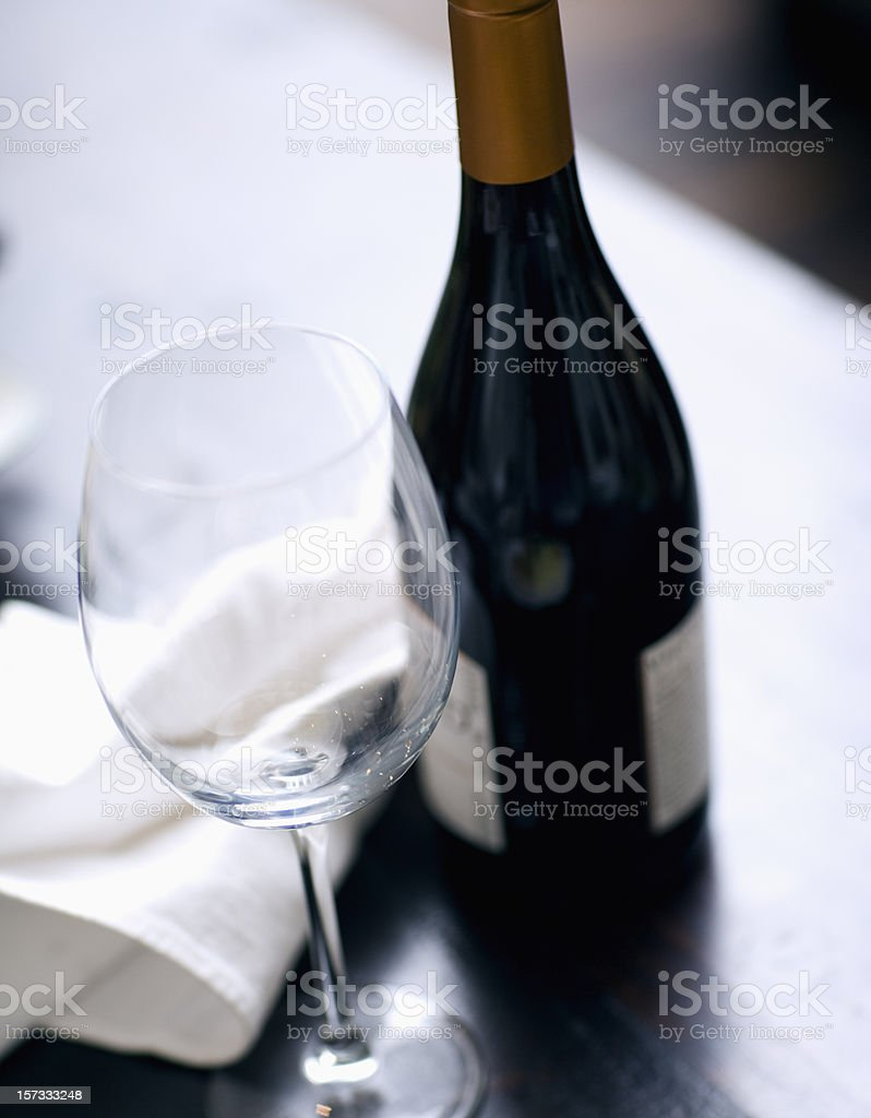Elegant red wine in a fall setting with deep rich colors, napkin in...