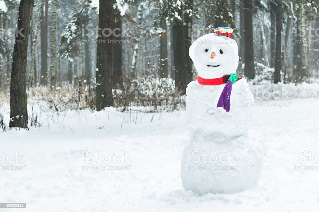 Holiday winter three snowball snowman with hat and scarf stock photo
