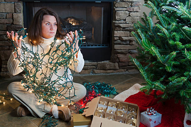 holiday woes - tangled stock photos and pictures