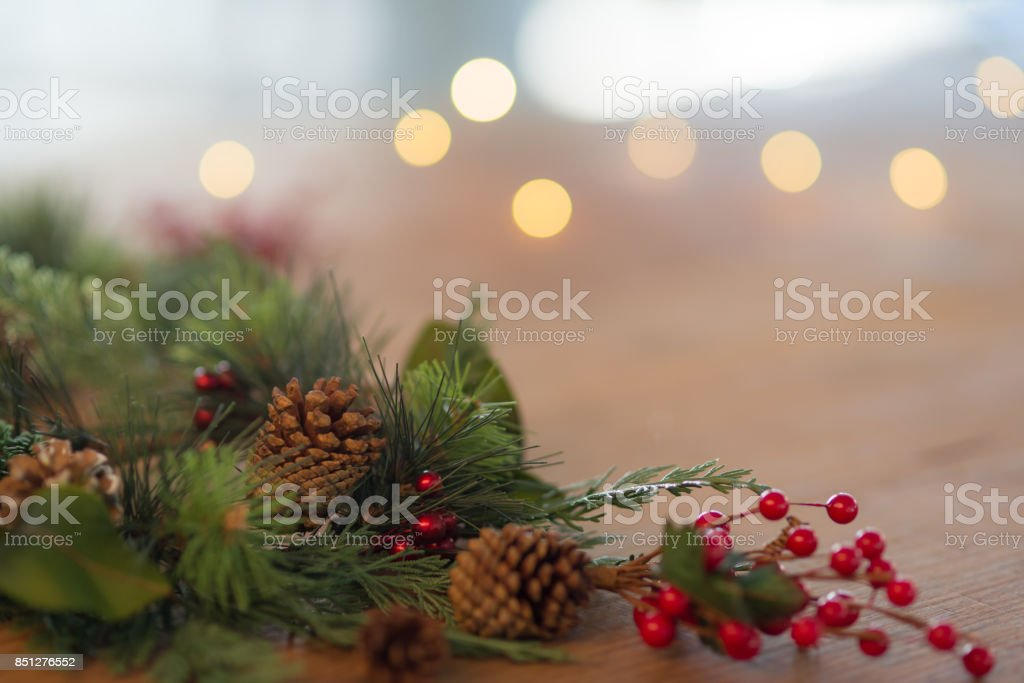 Holiday wreath on wooden table