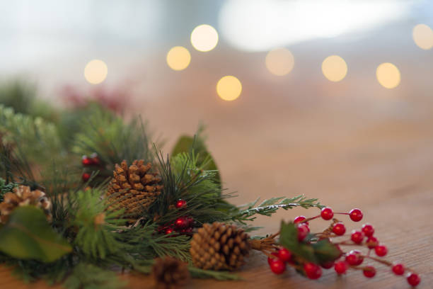 Holiday wreath on wooden table stock photo