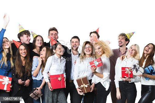 627933752istockphoto Holiday. Young beautiful people having fun on a white background. 1084279518