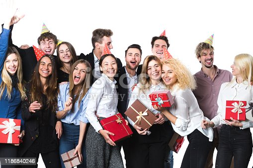 627933752istockphoto Holiday. Young beautiful people having fun on a white background. 1186840246