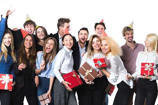 627933752 istock photo Holiday. Young beautiful people having fun on a white background. 1186840246
