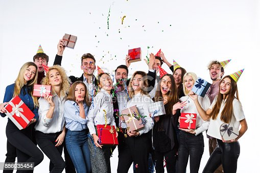 627933752istockphoto Holiday. Young beautiful people having fun on a white background. 886035454