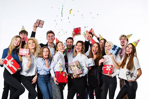 627933752 istock photo Holiday. Young beautiful people having fun on a white background. 886035454