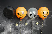 holidays, decoration and party concept - air balloons for halloween over black background.Top view